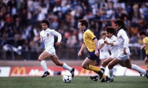 Valencia's Mario Kempes is hot on the heels of Liam Brady as the Arsenal player surges forward.
