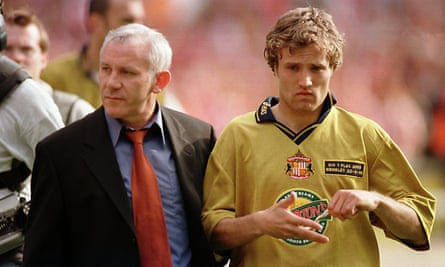 Gray walks off the pitch with manager Peter Reid after missing the last penalty in the shootout.