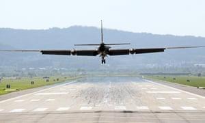 A U-2 reconnaissance aircraft lands at an air base