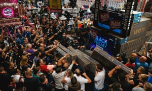 São Paulo, Brazil. Shoppers scramble to buy TV sets at a supermarket during a Black Friday sale