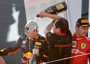 Red Bull's Max Verstappen receives a soaking as he celebrates on the podium.