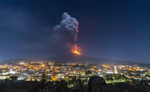 Pedara, Italy: Flames and smoke billowing from Mount Etna tower over the city in Sicily