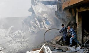 Syrian soldiers inspect the wreckage of a building described as part of the Scientific Studies and Research Centre compound in the Barzeh district, north of Damascus.
