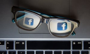 Facebook's logo reflected in a pair of glasses