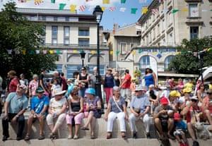 People enjoy the entertainment at Place du Martouret