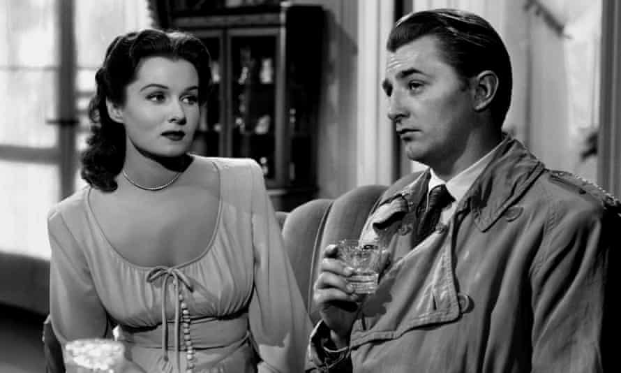 Fleming, left, with Robert Mitchum in Out of the Past
