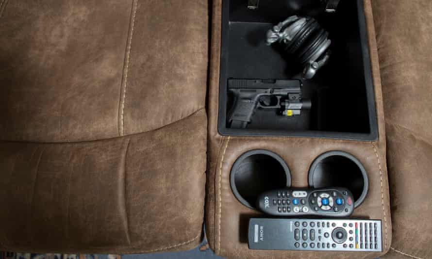 A handgun is concealed in a couch for home defense.