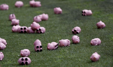 Toy pigs lie on the side of the pitch at the Valley after being thrown onto the field of play by both sets of fans.