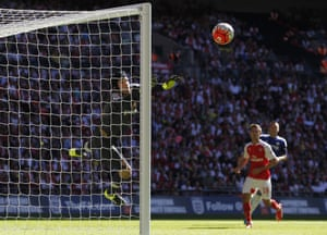 Petr Cech makes the save.