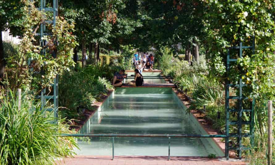 A garden and pool area on viaduct.