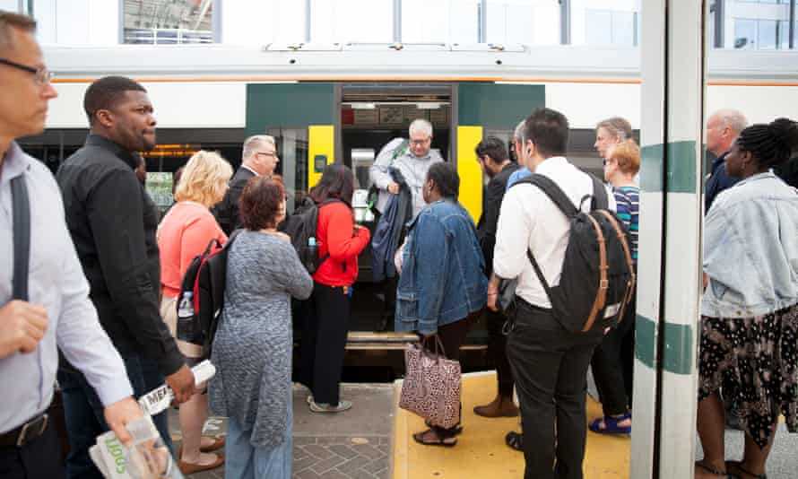 People wait to board a Southern train.