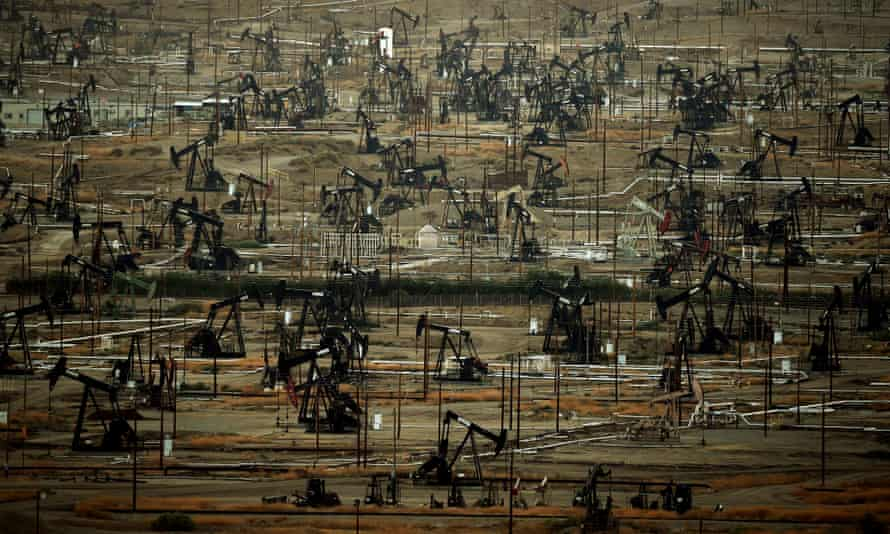 Oil pumping jacks and drilling pads at the Kern River oil field in Bakersfield, California.