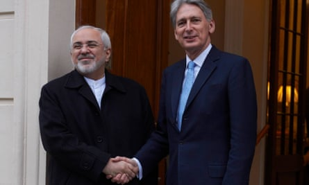 Philip Hammond shakes hands with  Mohammad Javad Zarif