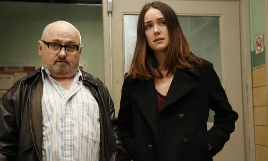 Clark Middleton with Megan Boone in The Blacklist.