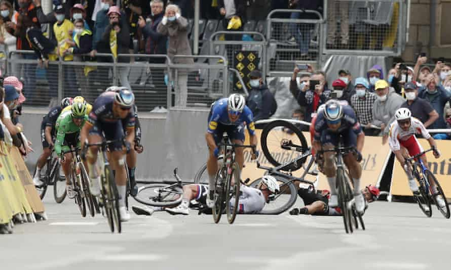 Peter Sagan and Caleb Ewan crash during the sprint towards the finish line of the third stage of the Tour de France in Pontivy