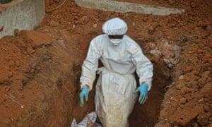 Burying unidentified bodies in Freetown, Sierra Leone