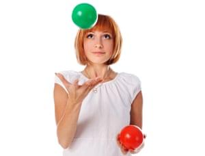 Girl juggling two balls