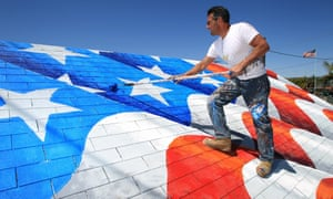 Self-titled 'patriot artist' … Scott LoBaido, who has painted American flags in all 50 states, on the roof of a building in California.