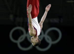 United States' Logan Dooley performs during the qualification of the men's trampoline.