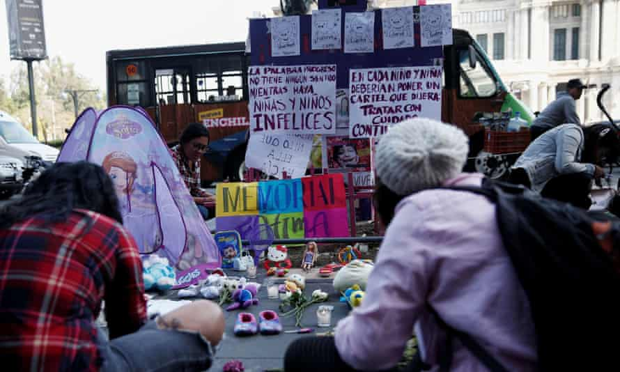 People gather in memory of seven-year-old Fátima Aldrighetti Antón at an anti-femicide monument in Mexico City, Mexico, on 19 February.