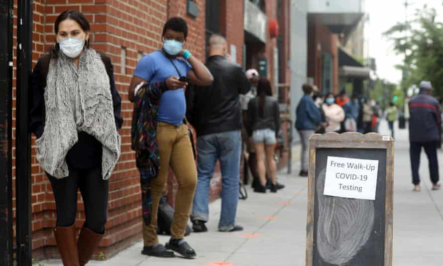 People wait in line for coronavirus testing in Washington.