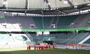 Bayern Munich fans take a lap of honour around Wolfsburg's empty Volkswagen Arena.