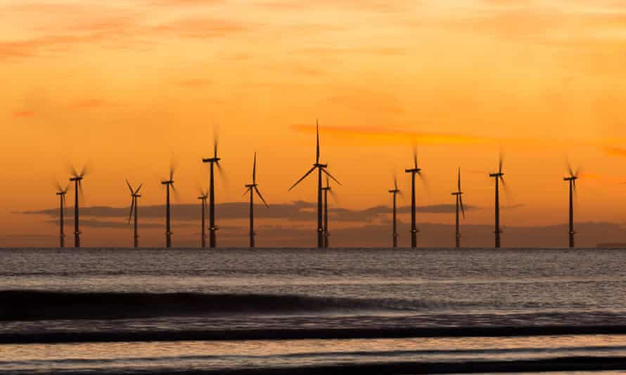 Sunrise from Seaton Carew beach near Hartlepool, northern England, with the Teesside offshore windfarm in the distance.
