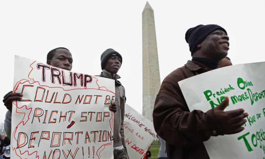 Immigrant families and their supporters march past the Washington Monument on 30 December to protest against the Obama administration's plans to target undocumented immigrant families in a series of raids early this year.