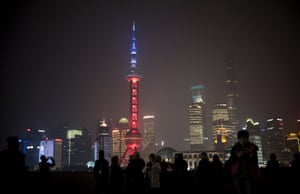 The Oriental Pearl tower in Shanghai is lit in red, white and blue as the Chinese express their solidarity with France.