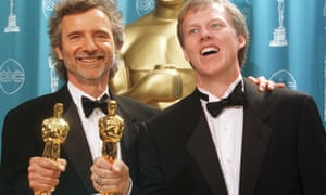 Curtis Hanson, left, and Brian Helgeland celebrate with their Oscars after winning best adapted screenplay for L.A. Confidential at the 1998 Academy Awards.
