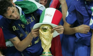 Marco Materazzi puts an Italian hat on the World Cup.