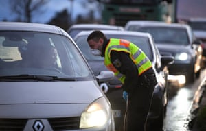A German police officer wearing a face mask monitors drivers at the French-German border between the cities of Strasbourg and Kehl.