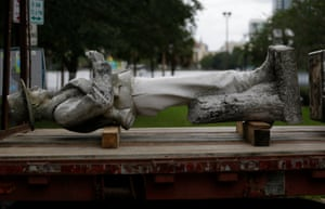 "In June, the top section of a Confederate statue called ""Johnny Reb"" was loaded on a truck before being removed from a downtown park in Orlando, Florida"