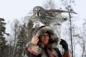 Krasnoyarsk, Russia. A two-year-old great grey owl sits on the head of Daria Koshcheyeva, an ornithologist, during a training session in the Siberian taiga