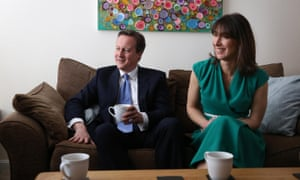 David Cameron and his wife Samantha visit the home of voters in Swindon, England.