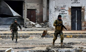 Pro-government forces advance during a military operation in the Syrian city of Aleppo on Wednesday.