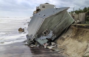 A house slides into the Atlantic Ocean at Ponte Vedra Beach
