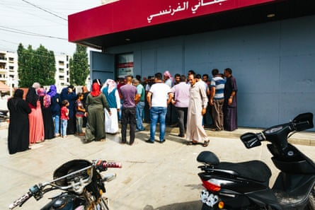 People queuing for an ATM machine in the town of Akkar, in Lebanon, on 14 July.