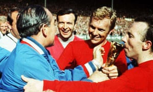 Bobby Moore (second right), manager Alf Ramsey (left) and Nobby Stiles (far right) with the Jules Rimet trophy, Wembley, 1966.