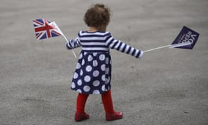 Small girl with Union Jack and Remain flags