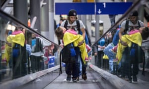 Refugees arrive at the airport train station in Düsseldorf, Germany, early on 9 September.