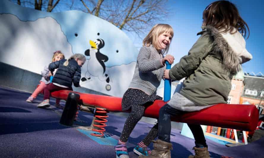 Children from a kindergarten in Copenhagen play in the city's Tivoli gardens.