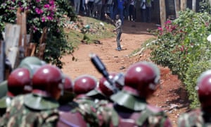 Anti-riot police attempt to disperse protesters in Kawangware slums in Nairobi, Kenya.