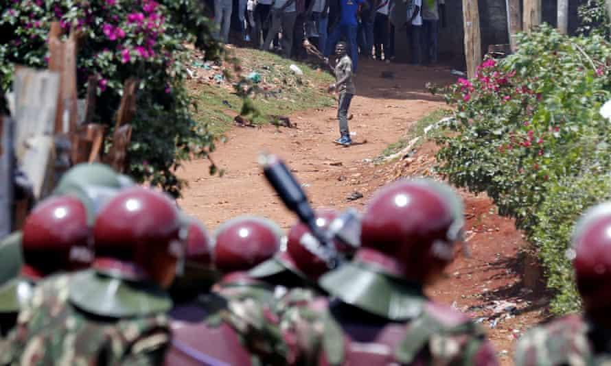 Anti-riot police attempt to disperse protesters in Kawangware slums in Nairobi, Kenya.