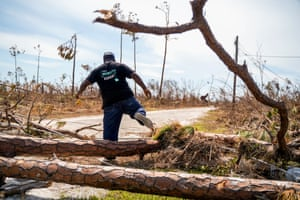 Pastor Pedyson Baillou makes his way to his destroyed home in the High Rock neighborhood in the eastern part of Grand Bahama island on Friday.