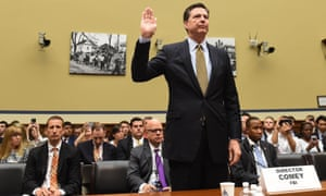 James Comey swears an oath before the House oversight committee before testifying about the investigation into Hillary Clinton's email system.