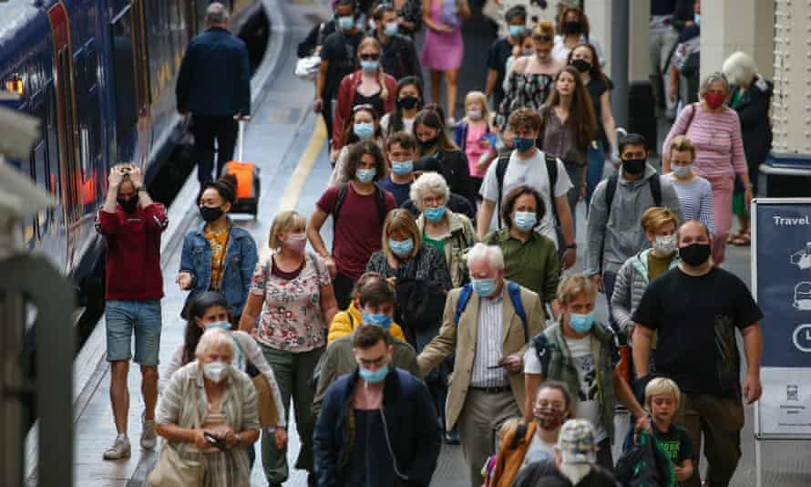 Passengers wearing face masks at Waterloo station in London.