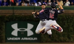 Francisco Lindor (right) and Rajai Davis celebrate clinching victory in Game 4