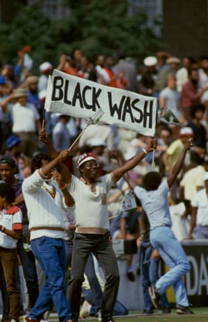 Jubilant West Indies supporters holding up a 'Black Wash' banner during the Fifth Test Match between England and the West Indies at the Oval, London, 1984.