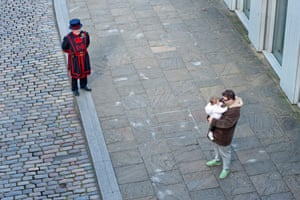 Yeoman warder Gary Burridge practising 'social distancing' with fellow beefeater Andy Shedden and his daughter, Eliza. All the beefeaters are under lockdown, they were the only staff in the Tower